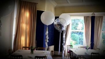 Sliver and  white balloon decor at Stretton House, Alfreton Derbyshire.  Wedding anniversary decorations.