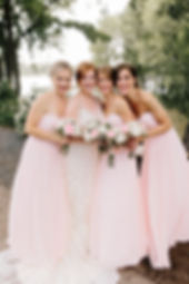Bridesmaids with pink wedding gowns