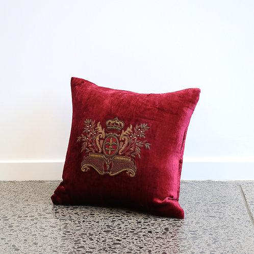 Red velvet cushion, adorned with antique gold crest