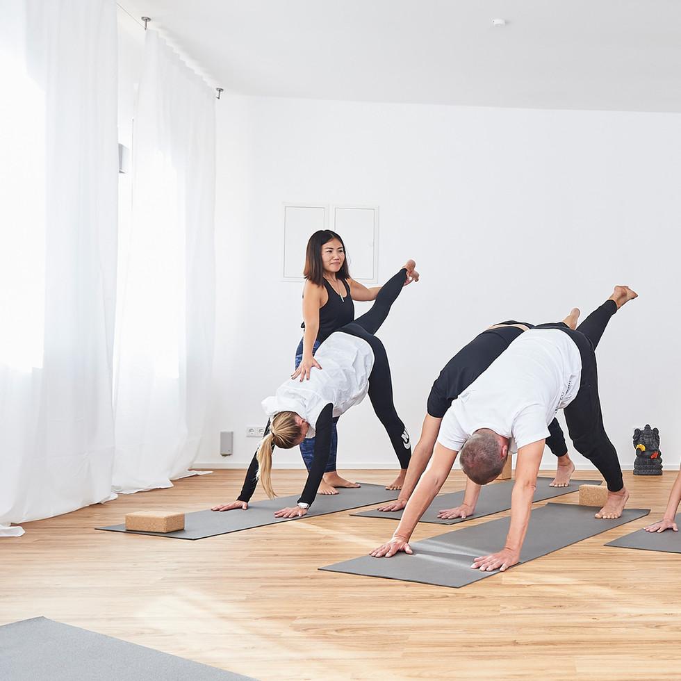 Assisting participants of a Yoga class