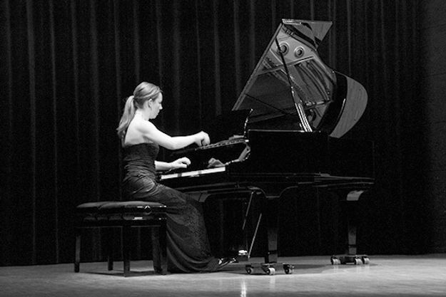 Stephanie Gurga playing piano reflection