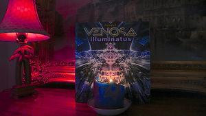 Illuminatus_book_w_candleVenosa.jpg