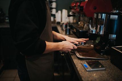 barista pulling coffee shot