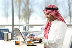arab-saudi-man-working-online-with-a-laptop