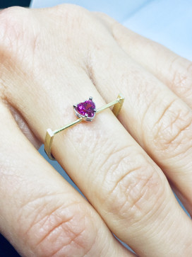 Yellow and white gold ring set with a heart tourmaline