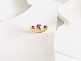 Yellow and white gold ring set with rubies and diamonds