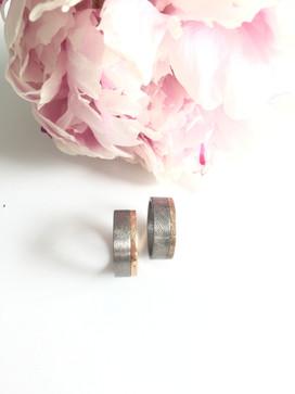 Rose gold and titanium wedding rings