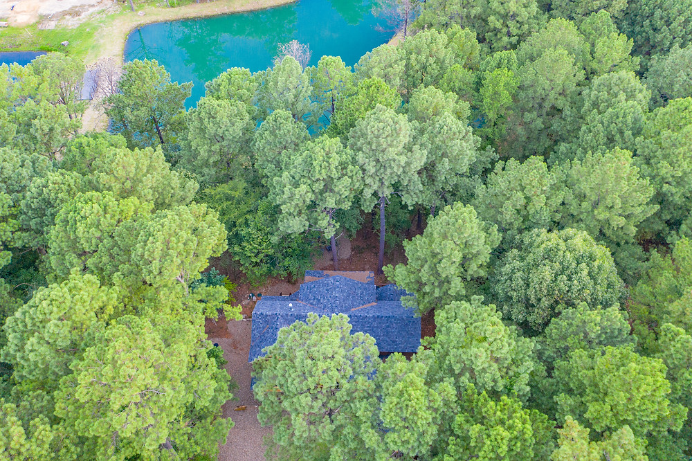 Ariel view of vacation home surrounded by trees in Broken Bow Oklahoma