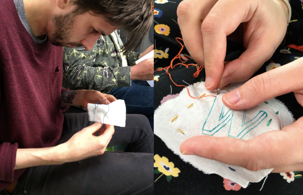 Young man sewing a cloth badge, with a  close up of sewing hands