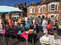 Photo of the the authors' neighbours taken at a street party for The Great Get Together in 2019