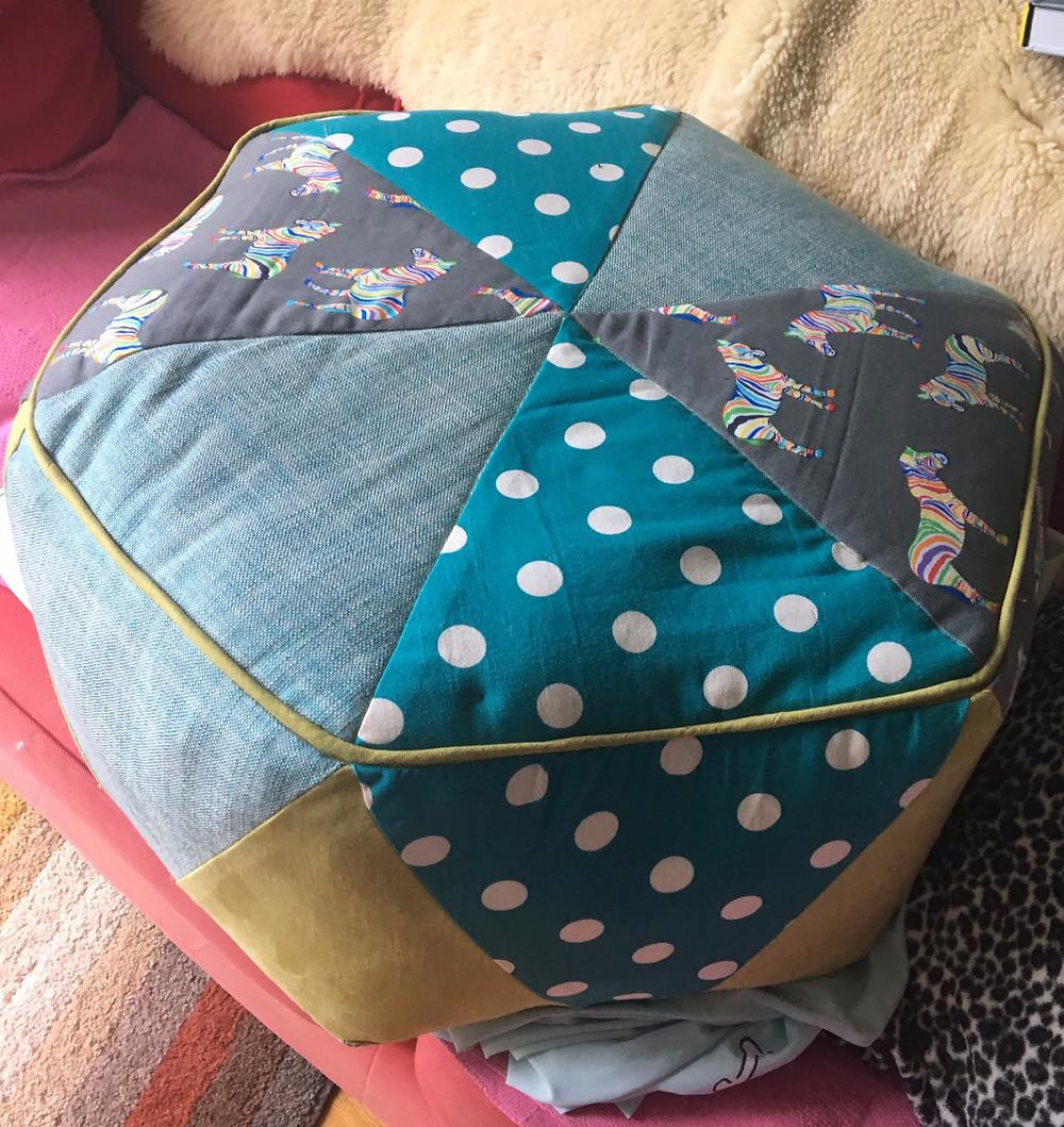 an hexagonal patchwork pouffe