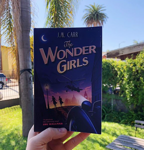 The Wonder Girls paperback against a backdrop of Californian palm trees