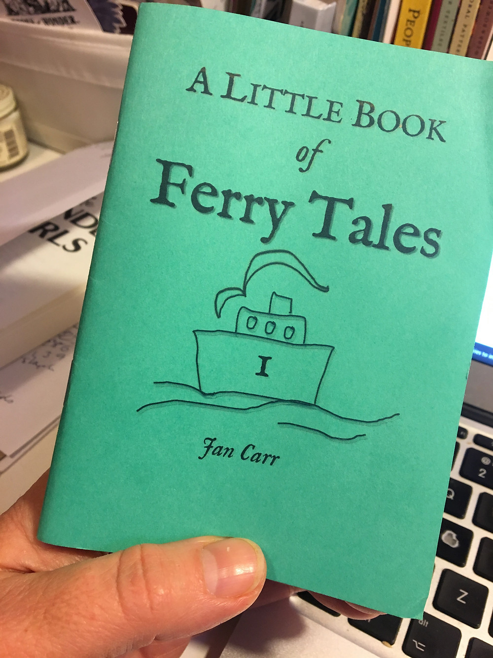 made at home sample mock up of A Little Book of Ferry Tales, green cover with title and a naive line drawing of a ferry boat.