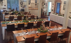 Tables set in the Cookshop