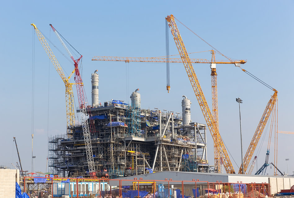 Chemical plant under construction with big crane.jpg