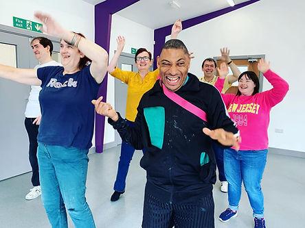 Six people taking part in dance workshop