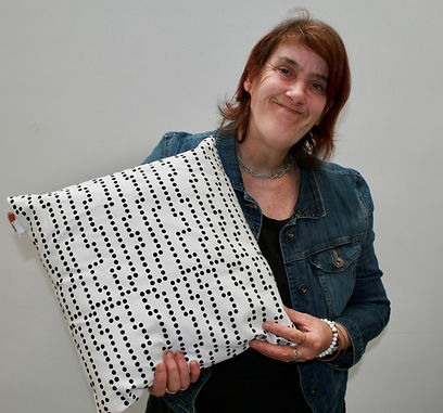 Cathy with white cushion with black dots designed at artworks south yorkshire