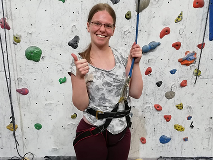 ArtWorks outings- woman ready to climb rock wall