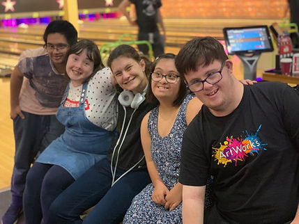 five people playing bowling