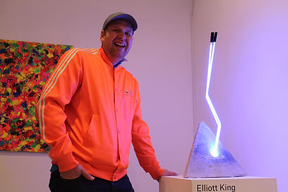 Elliott with his neon artwork at exhibition