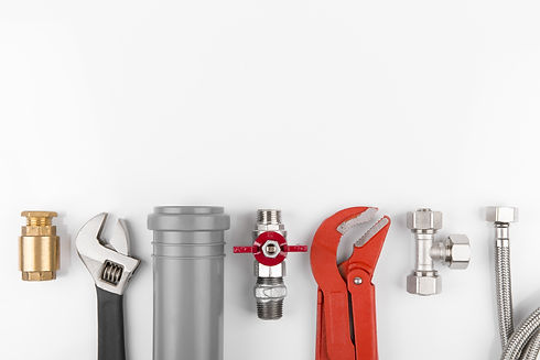 plumbing tools and equipment on white with copy space.jpg