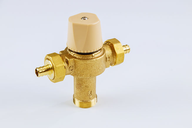 Plumbing connection with close up water brass thermostatic mixing valve isolated on white background