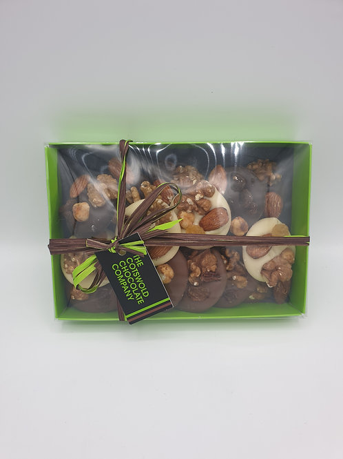 Dark, milk and white chocolate fruit and nut mendiants box.