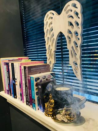 Books with Sage burning.jpg