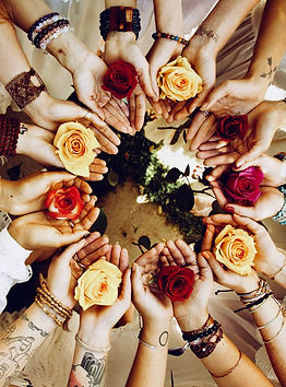 Circle with flowers in womens hands.jpg
