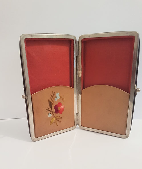 Vintage glasses and handkerchief case.