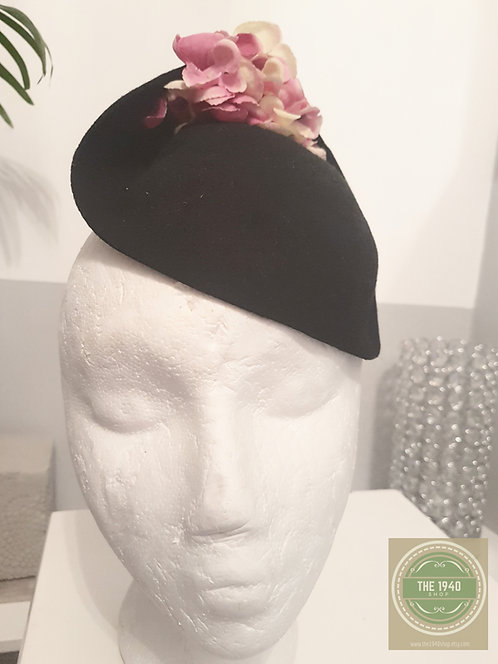 Black hat with pink and cream flowers