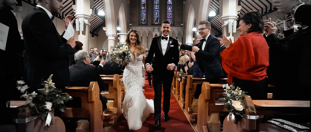 Bride and Groom walk down the Aisle after marriage ceremony
