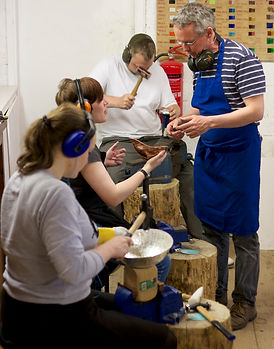 Seamus teaching at a silversmithing work