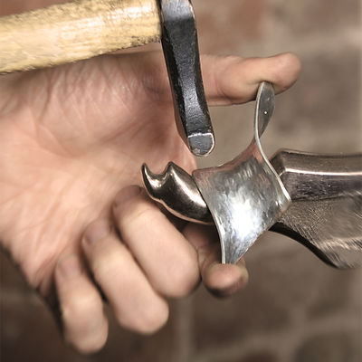 Hammering out a silver twist pendant.jpg