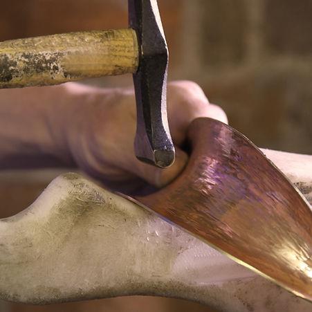 hammering a bronze anticlastic.jpg