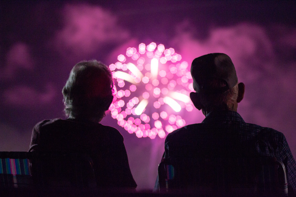 A couple watches 4th of July fireworks together just outside of Boerne, Texas. They gather at that spot each year with their three children and seven grandchildren to watch the fireworks.