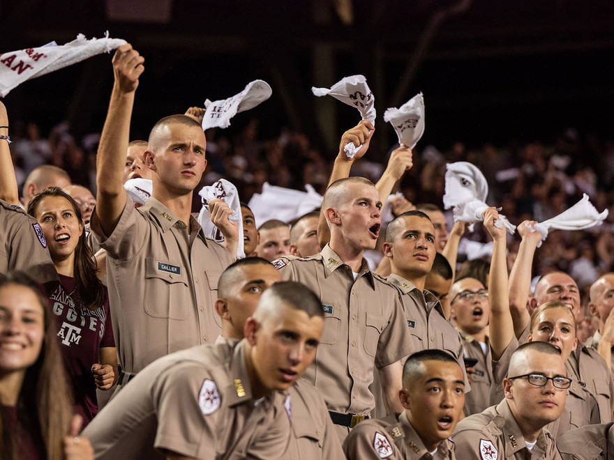 Freshmen in the Corps of Cadets wave their 12th Man Towels and yell during a football game.