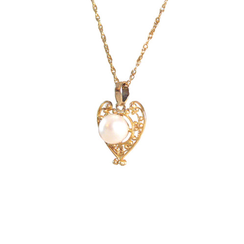 Vintage pearl heart 14k gold filigree pendant the goldsmiths a petite pearl heart pendant crafted out of 14k yellow gold converted to a pendant from a vintage stick pin pearls the birthstone of june has long been a mozeypictures Images