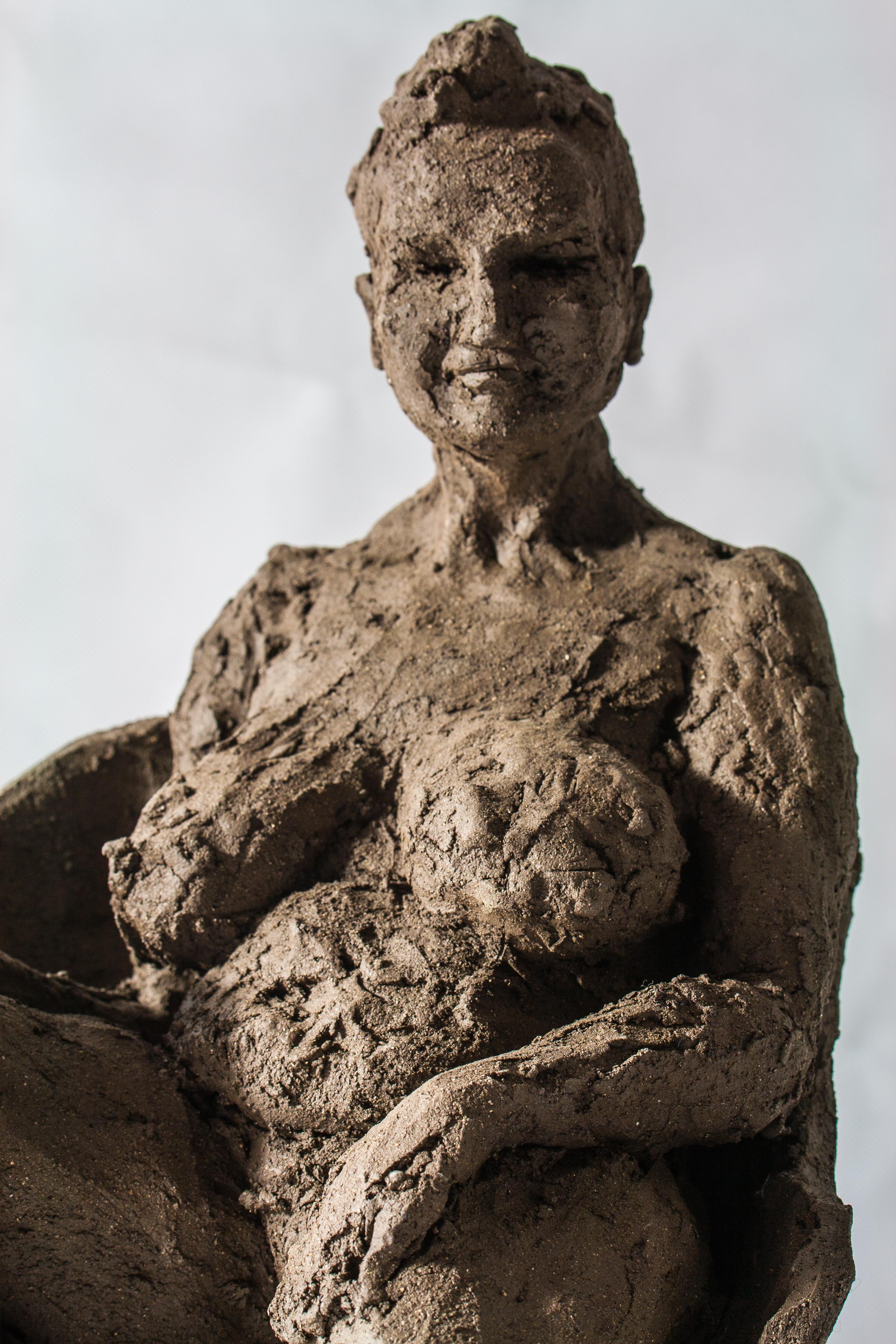Femme nue sur fauteuil