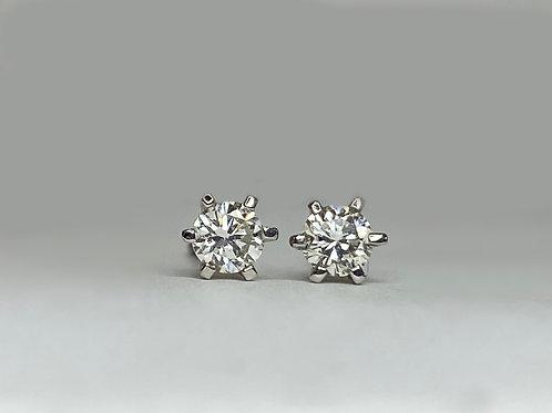 Aretes seis uñas de diamante