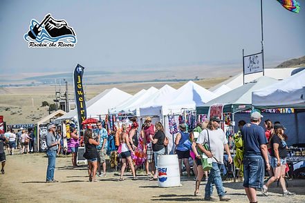 Line of vendor booths at Rockin the Rivers music festival