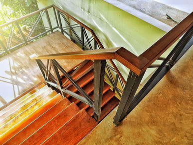 Metal staircase railing with wooden stai