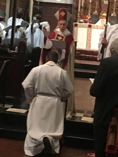 Fr. kneeling.JPG