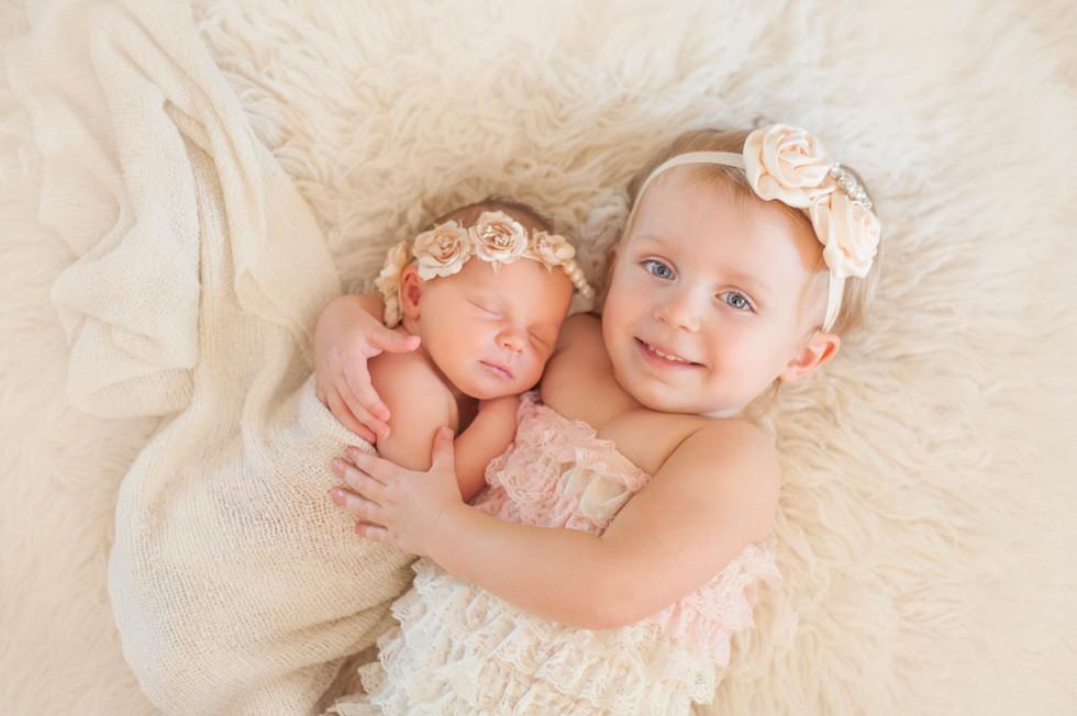 Sisters cuddling Newborn Session
