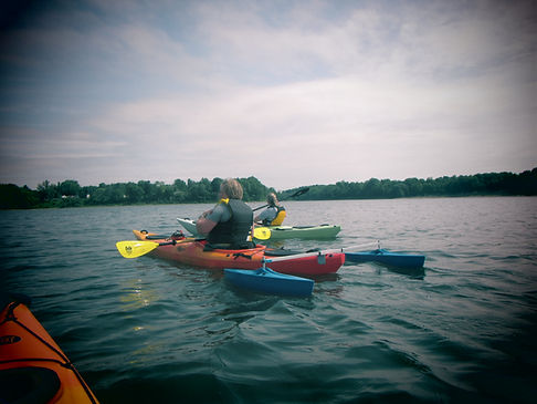Outriggers in action assisting kayak on the lake