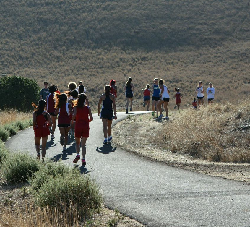 XC runners race past beautiful scenery. Photography by Mary Jo Ashby