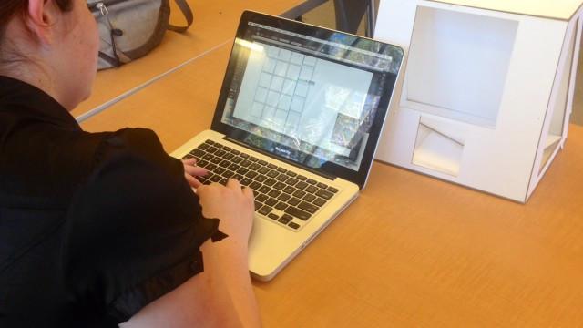 Junior Miriam M.P. sets up the basic Battleship design to rework.  Photography by Allie N. '16