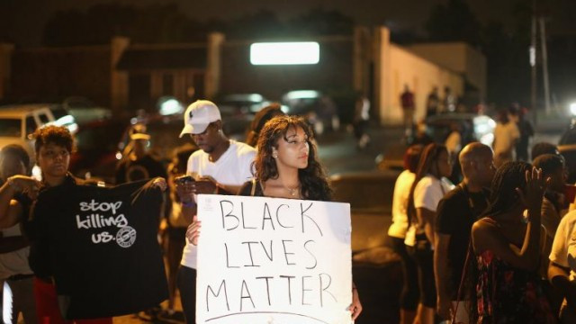 Protestors gather to express their opinion in the racial and ethical turmoil of Ferguson, MI.  Source: http://s1.ibtimes.com/