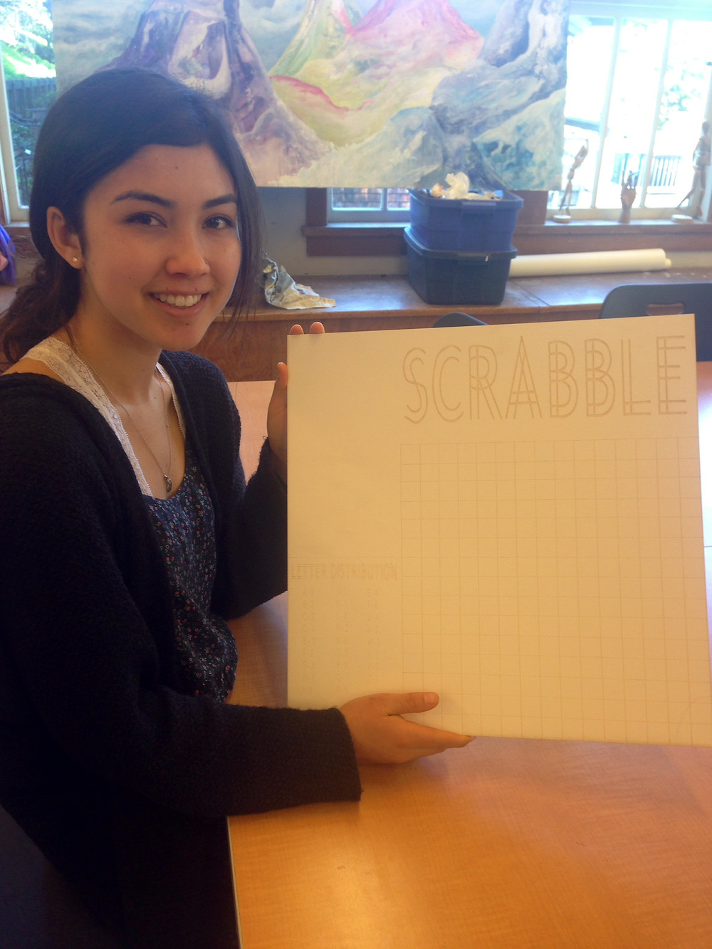 Mari K. '15 shows off a sketch of her redesigned Scrabble board game. Photography by Allie N. '15
