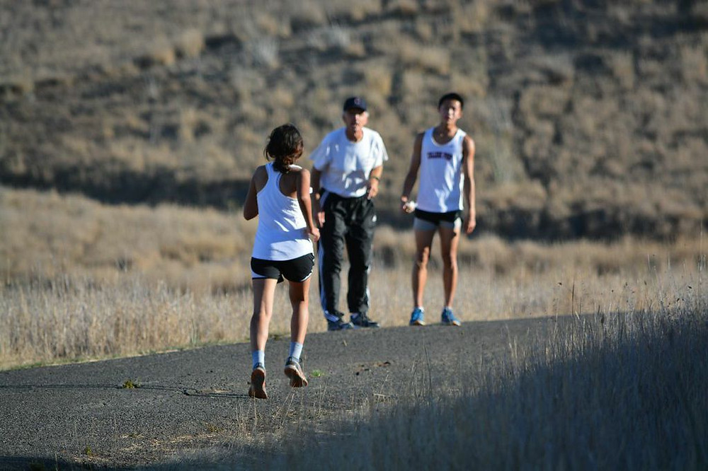 Ameya F. powers on to words of encouragement by XC coach Mr. Coakley Photography by Mary Jo Ashby